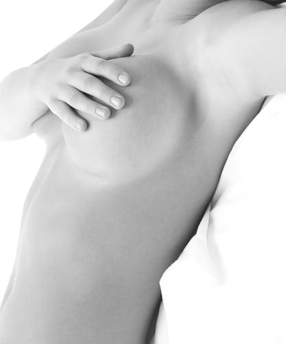 Black and white photographs of the left side of a woman with her hand covering her left breast