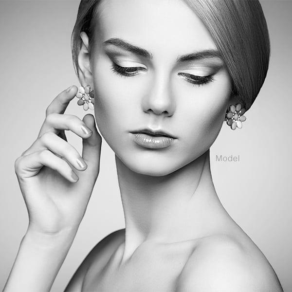 Woman touching earring