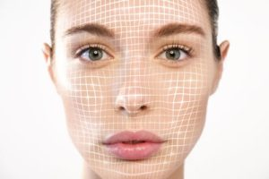a beautiful woman for facial recognition and facial lifting for rejuvenation