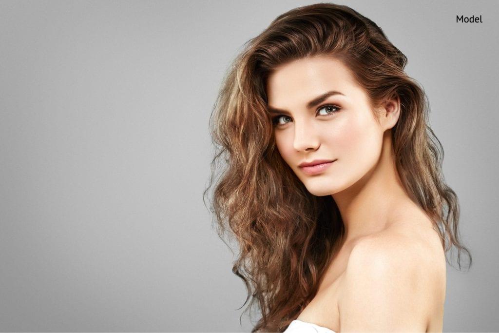 amazing woman portrait. beautiful girl with long wavy hair-img-blog