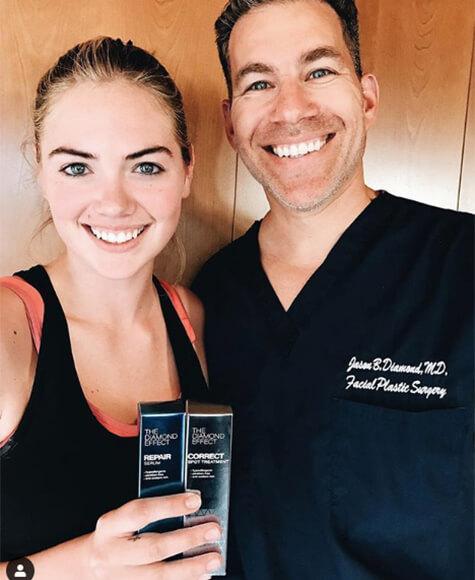 Kate Upton with Dr. Diamond, holding The Diamond Affect: repair serum, correct spot treatment